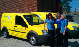 Servicemaster Commercial Cleaning Swansea Team in front of a few vans from the fleet